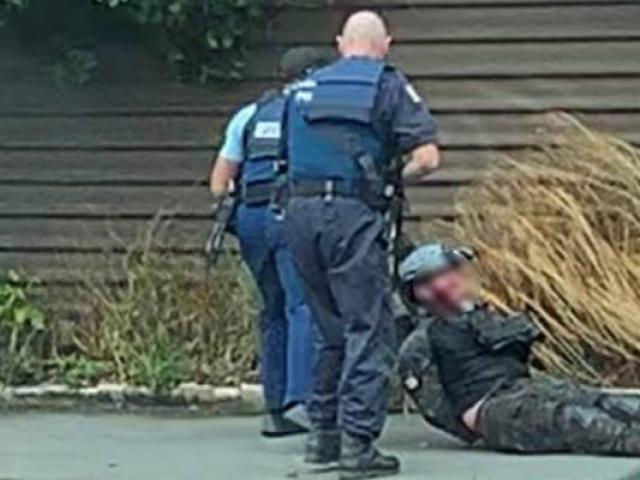 The moment the two officers caught the alleged shooter. Photo: Supplied