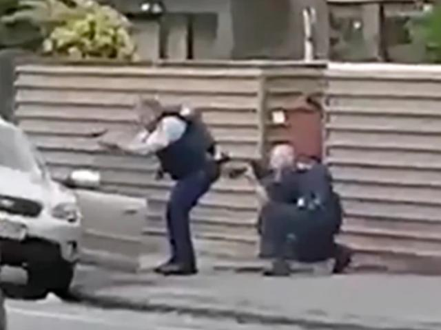 The moment two hero police officers captured the man accused of shooting dead 51 people at two...
