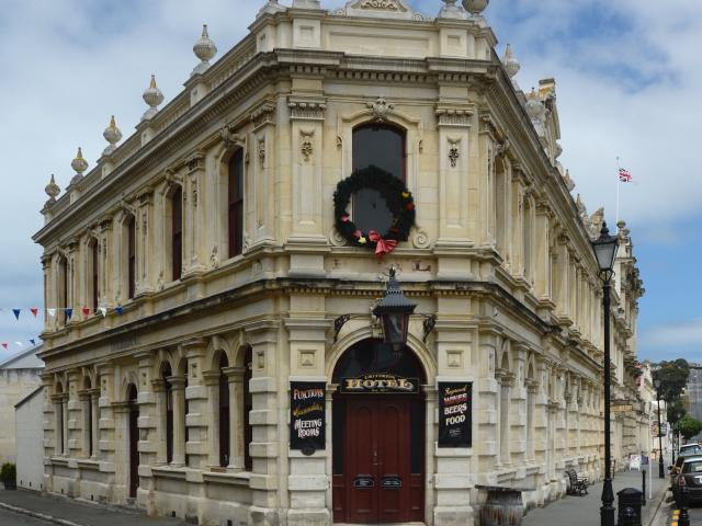 The Oamaru Whitestone Civic Trust has bought the business that runs from its 1877 landmark hotel...