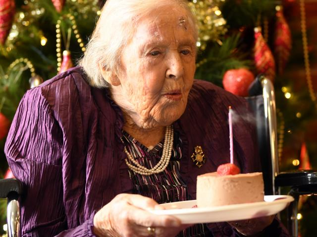 Dawn Ibbotson marks her 105th birthday with cake and a candle. PHOTOS: STEPHEN JAQUIERY