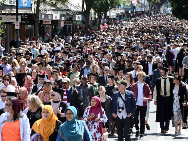 Hordes of graduands and supporters march down George St during the year's final University of...