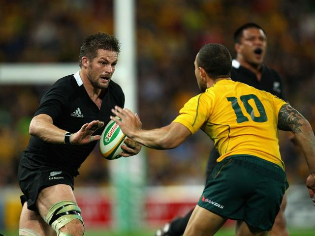Quade Cooper (10) prepares to tackle Richie McCaw during an All Blacks v Wallabies game in 2011....