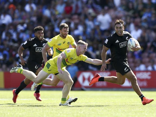 Joe Webber of New Zealand gets away from Henry Hutchison of Australia during the semi-final match...