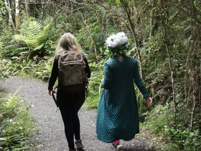 The writer (left) undergoes some nature therapy at Orokonui with tahu Mackenzie.