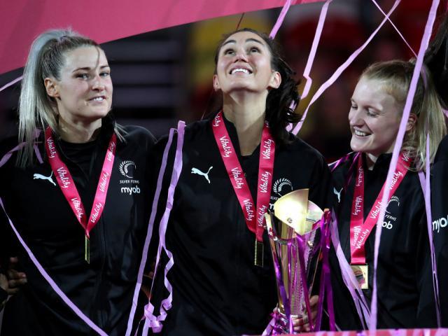 New Zealand's Ameliaranne Ekenasio celebrates with team mates after winning the Vitality Netball...