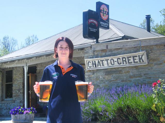 Chatto Creek Tavern staff member Ellen Naylor carries the essentials in front of the historic pub...