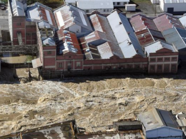 The flooded Mataura River rips past the former Mataura paper mill last week Photo: Stephen Jaquiery