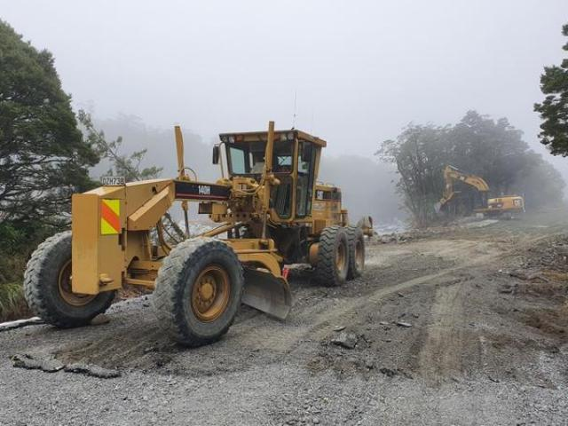 Work on temporary repairs for Milford Road underway earlier in February. Photo: NZTA