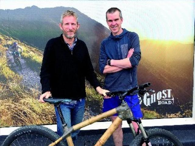 Richard Nichol (left) with the custom-built bamboo bike made for him by Glenn Irving, using...
