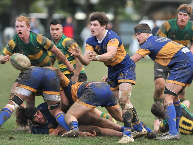 Taieri halfback Bob Martin clears the ball from a maul during a match against Green Island at...