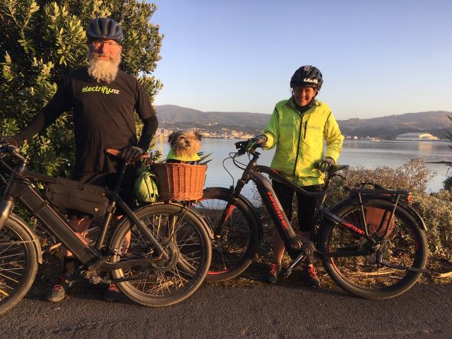 Mike, Dexter and Tania from electify.nz Dunedin enjoy their 40km daily commute...Photo supplied