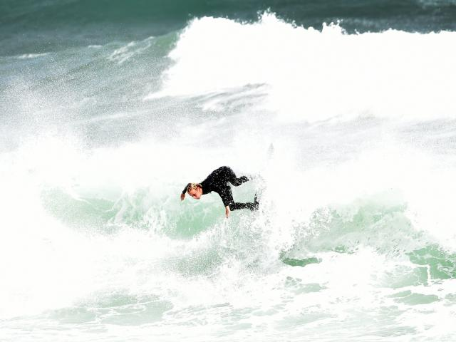 Surfer Jack Lee (17), of Whakatane, braves the choppy conditions at St Clair Beach on Saturday....