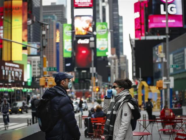 People walk through a nearly empty Times Square in New York City. Photo: Reuters