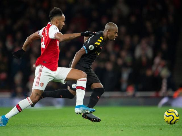 Pierre Emerick Aubameyang of Arsenal and Fernandinho of Manchester City compete for the ball...