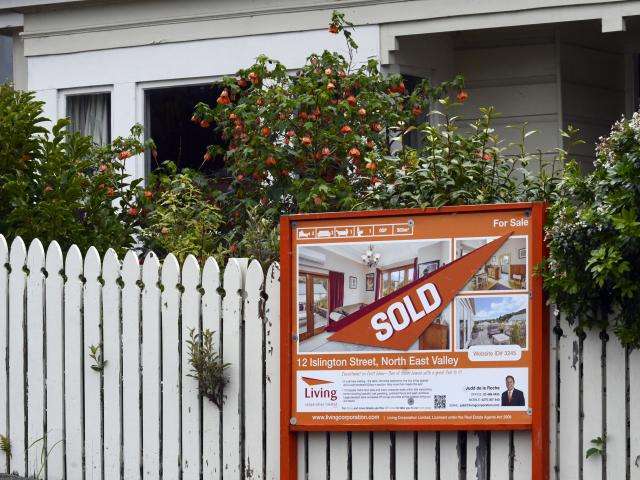 A sold sign hangs outside a house in Islington St, in Dunedin's Northeast Valley. PHOTO: GERARD...