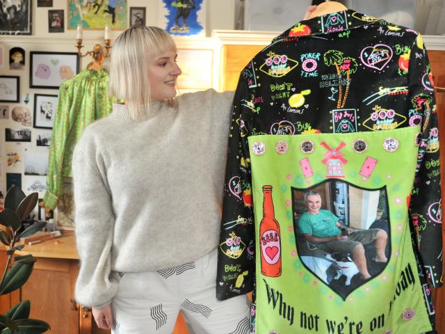 Ruby Van der Zanden, of Dunedin, holds a piece from her collection, a jacket with a photo of her...
