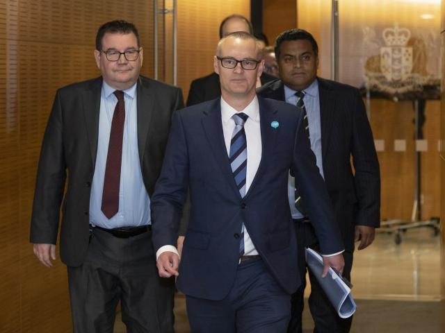 David Clark, flanked by colleagues Grant Robertson (left) and Kris Faafoi, arrives at Thursday's...