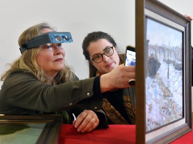 Dunedin Public Art Gallery paintings conservator Jenny Sherman (left) and intern Joanna Osborne...
