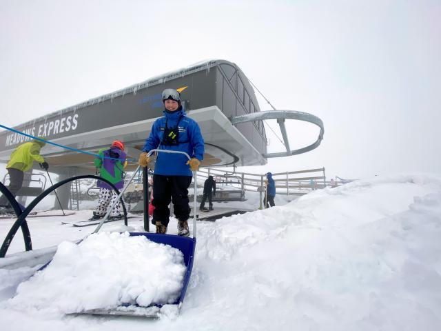 Hugo Huntington from the lifts crew at Coronet Peak removes snow at the ski resort yesterday....