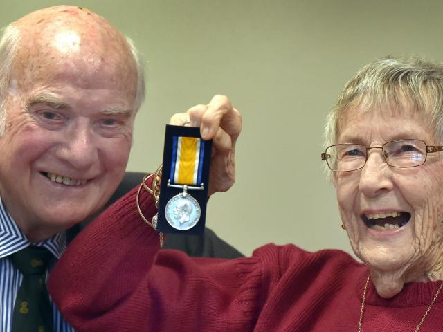 Huia Ockwell presents a British War Medal to Margaret McMaster, whose uncle William Manson served...
