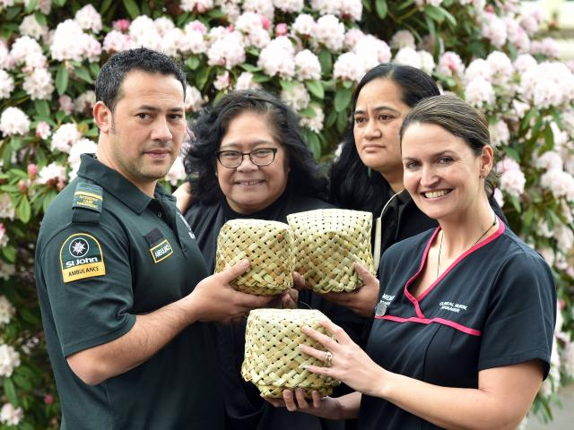 Holding some of the kete which will go in St John ambulances in Dunedin for miscarried babies are...