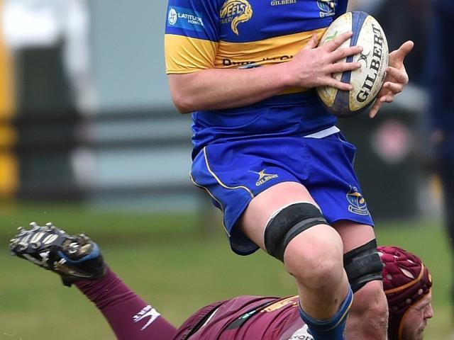 Taieri lock Brodie Hume tries to evade the tackle of Alhambra-Union hooker Alex Frood during a...