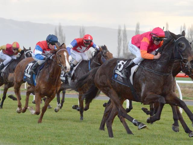 Asathought sprints past the field to win a maiden 1600m race at Wingatui yesterday.