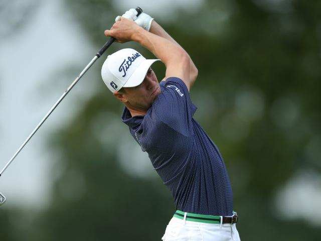Justin Thomas hits a tee shot on the 3rd hole during the first round. Photo: Brad Penner-USA...