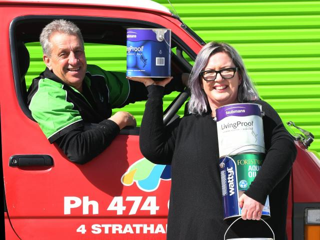 Rainbow Paints owners Paul and Karen Beres out the front of their new location on Strathallan St....