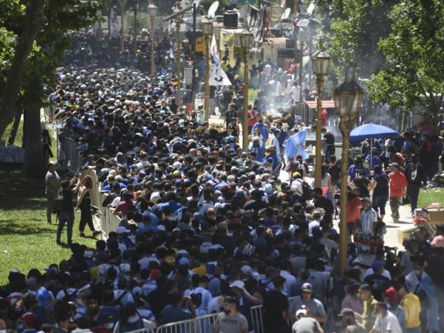 People flocked to the streets of Buenos Aires to mourn the death of Diego Maradona. Photo: Getty...