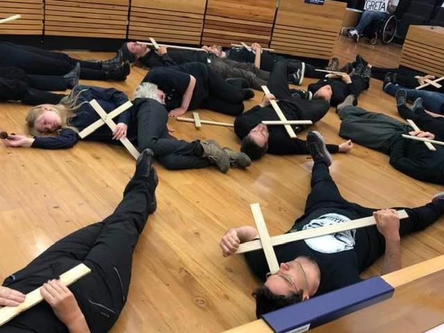 The protesters dressed in black and carried grave markers at the Christchurch City Council...