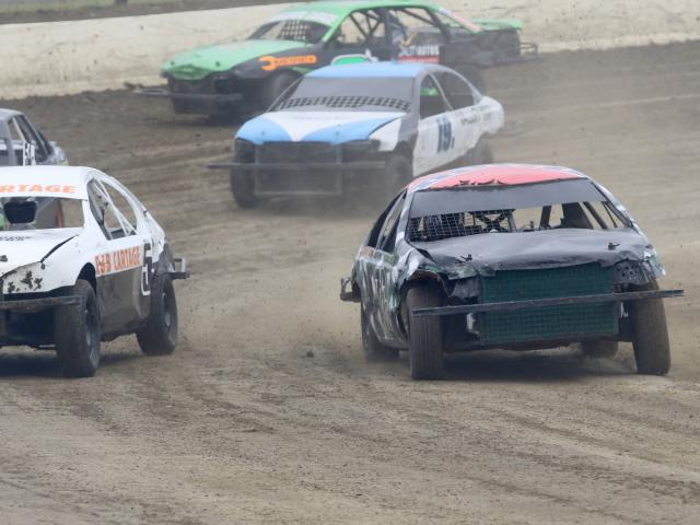 Richards slips up the inside of No54C Kirk Aldridge of Christchurch during a heat race. PHOTOS:...