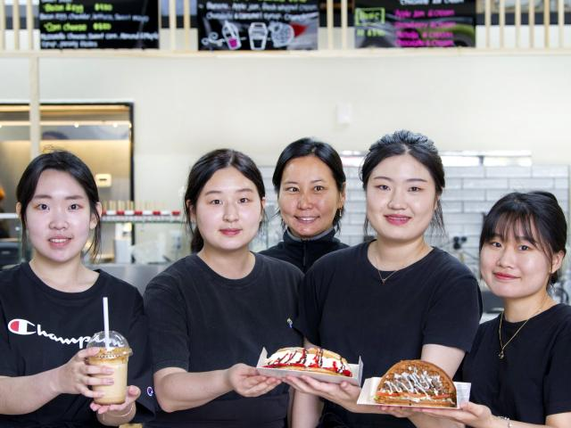 Crazy Waffle staff members (from left) Louise Kim, Hamin Yun, Ellie Jung, Lily Kim and Na Hyun...