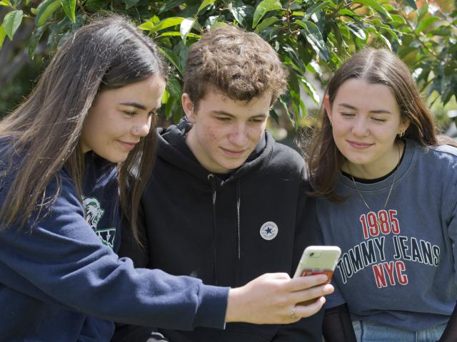 Former Kavanagh College year 13 pupils (from left) Emily Kerr-Bell (18), Sam Meikle (17) and...