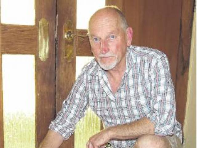 Black Ridge Vineyard director Joss Purbrick shows the water line in his cellar door tasting room;...