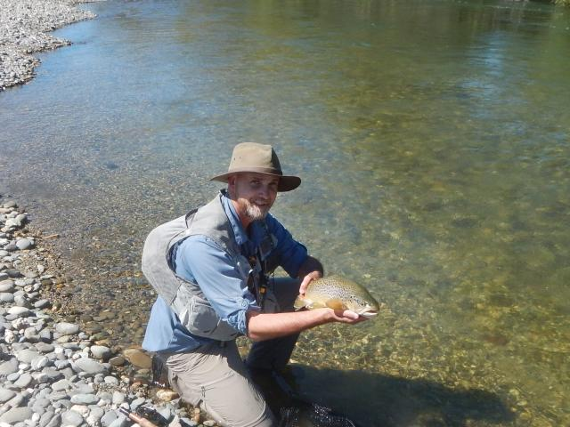 Bruce Quirey, my companion on the Mataura, with a nice trout on a perfect day.PHOTO: SUPPLIED