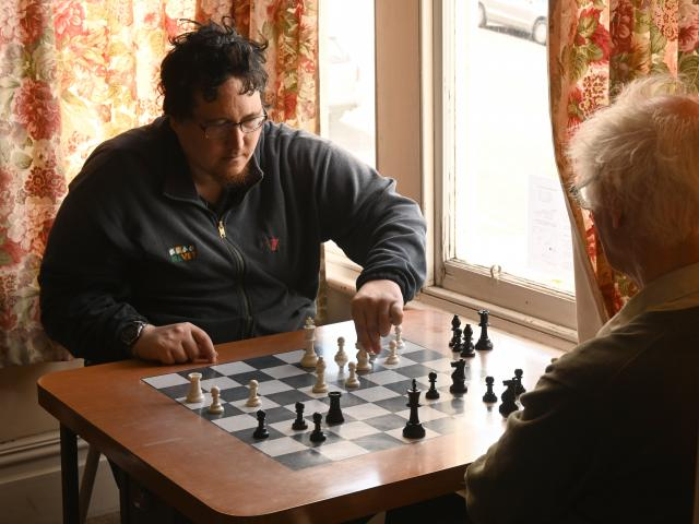 Hildon Nisa, of Dunedin, and David Reid, of Herbert (below) play a game of chess at the Otago...