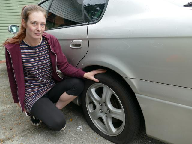 Clyde St, Balclutha, resident Ashlee Marshall inspects a tyre on her family car, one of multiple...