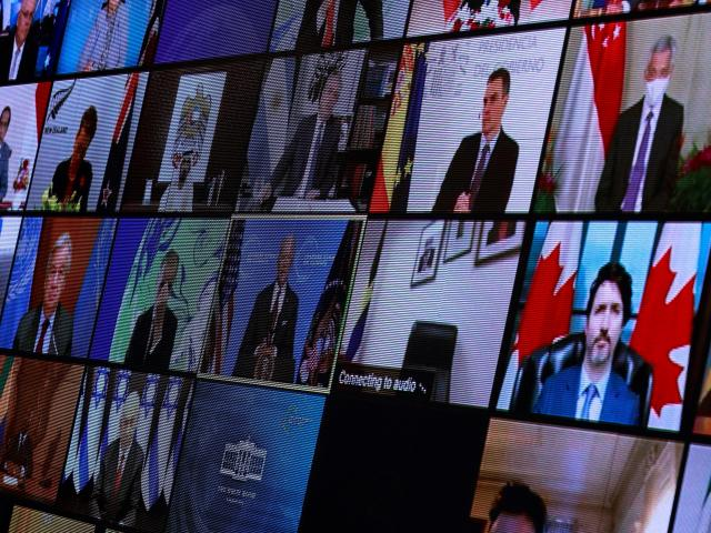 World leaders appear on screen during the virtual Climate Summit. Photo: Reuters