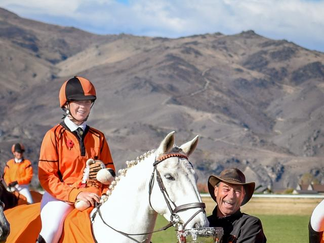 Otago-Southland coach Hamish Disbrowe holds the NZPCA Dressage Cup for highest placed MT-class...