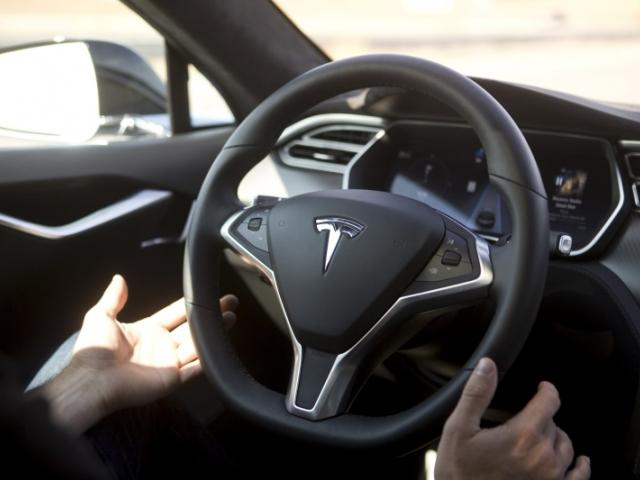 New Autopilot features are demonstrated in a Tesla Model S during an event in Palo Alto,...
