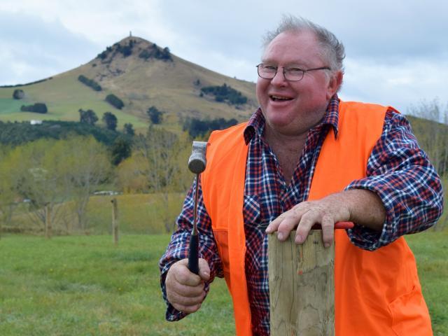 Fencing Contractors Association New Zealand board member Stephen Mee, of Winton, swings a hammer...