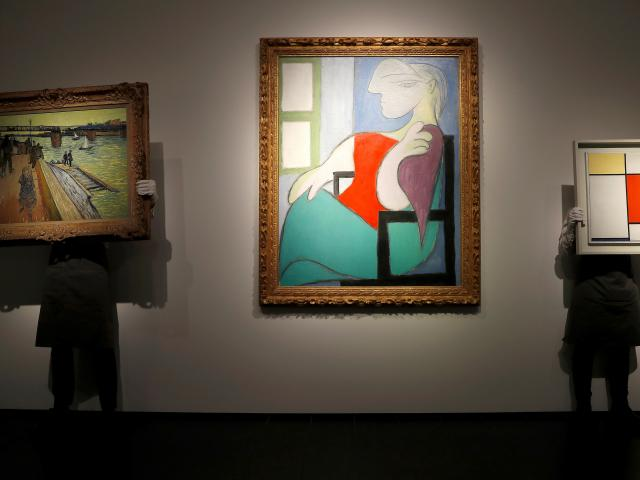 """""""Femme Assise Pres d'Une Fenetre (Marie-Therese)"""" by Pablo Picasso (centre). Photo: Reuters"""