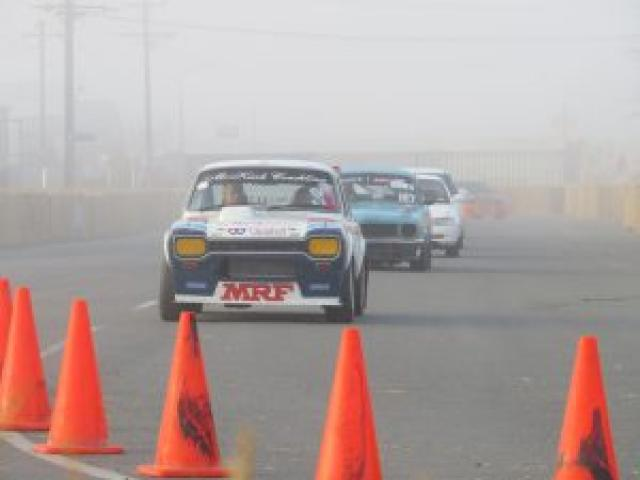 Donn McLaren in his customised Mazda Escort takes Kaitlyn Adams for a warm-up lap. Photo: Supplied