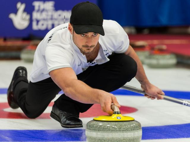 Anton Hood and Courtney Smith in action at the world curling mixed doubles championship in...