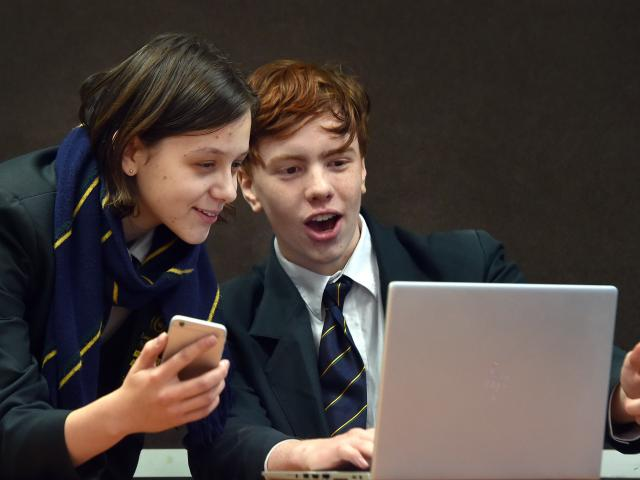 Bayfield High School pupils Veronika Luthar and Bradyn Brown (both 17) practise their computer...
