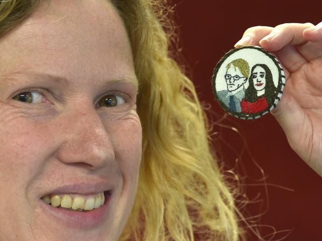 Jane McMillan with an Ashley Bloomfield and Jacinda Ardern brooch she designed for embroidering....