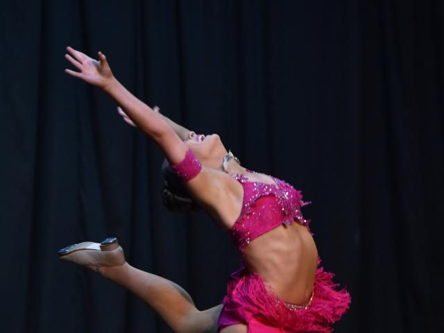Isabel Woodhouse struts her stuff on stage at the Dunedin Performing Arts Competitions Society...