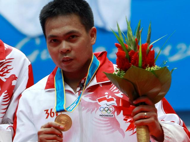 Markis Kido after winning the gold medal in the men's badminton doubles final at the Asian Games...