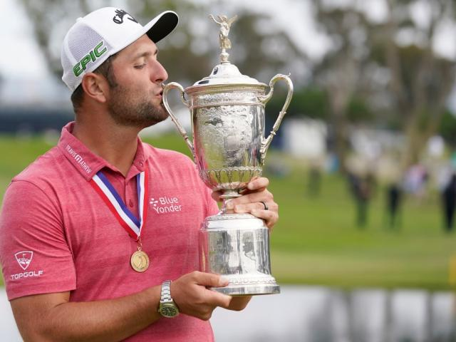 Jon Rahm kisses the trophy after winning the US Open at Torrey Pines Golf Course. Photo: Michael...